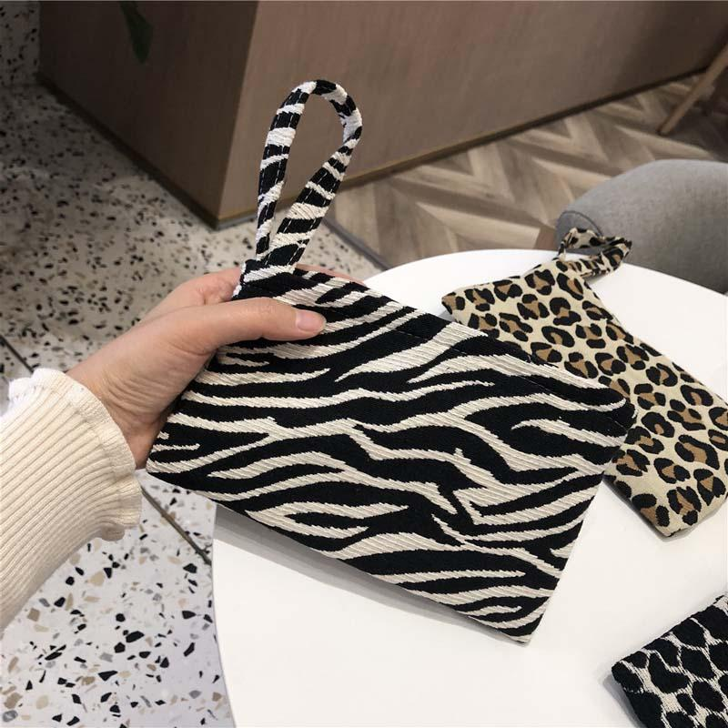 40 adet Cep Telefonu Çanta Cüzdan Bez Sanat El Taşıma Küçük Bez Çanta Moda Siyah Ve Beyaz Leopar Baskı Basit Eğlence Jakarlı Bez Çanta