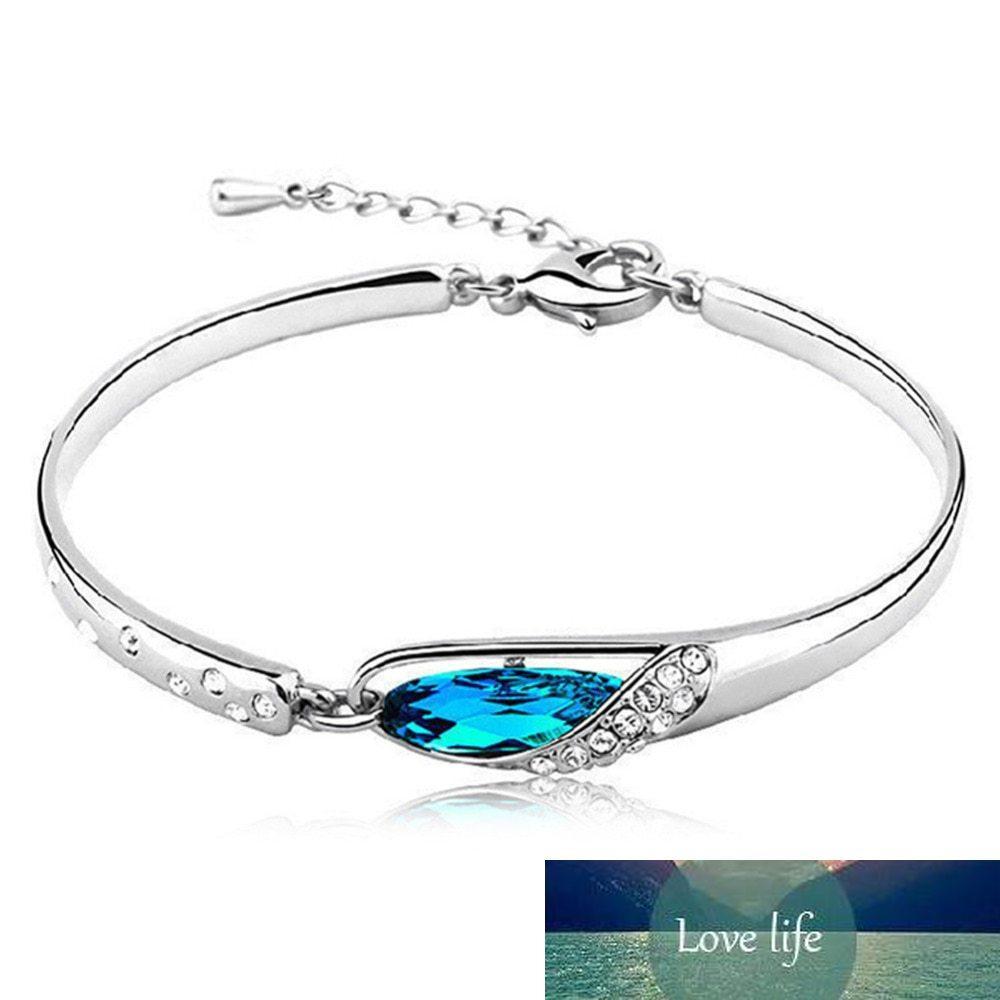 Pulsera de cristal azul excepcional Rhinestone incrustado Brazalete de cristal Joyería de cristal Color de plata Cadena de gota Envío