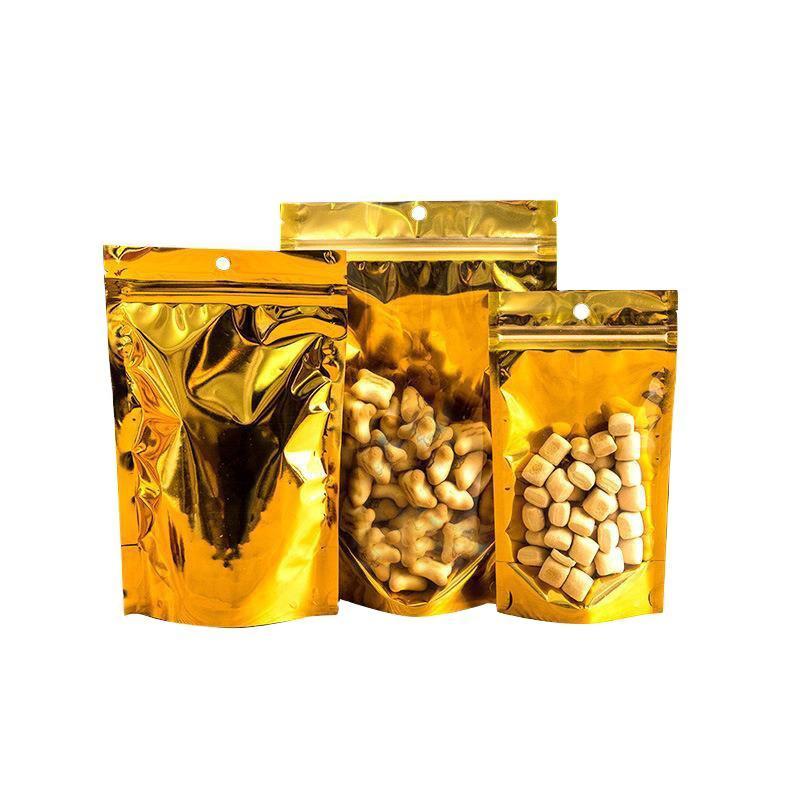 Bolsas de embalaje aluminizadas con cremallera de oro Resellable mate / transpare Bolsas de almacenamiento de alimentos secos de caramelo Spell Prueba de almacenamiento Bolsa de cremallera con agujero colgar