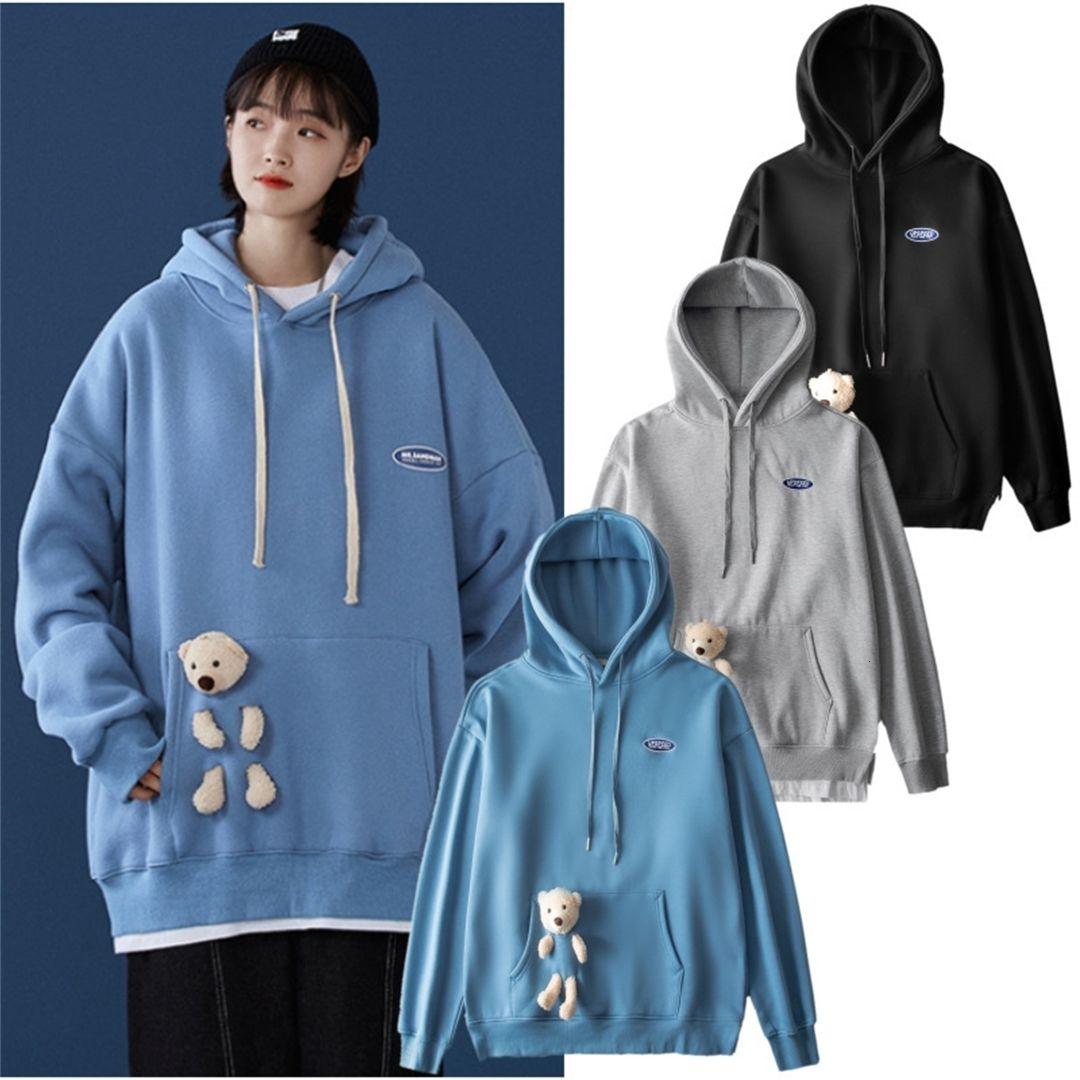 Otoño e invierno marea tres dimensiones suéteres versátiles de los hombres falsos sueltos color sólido con capucha con capucha abrigo de pareja