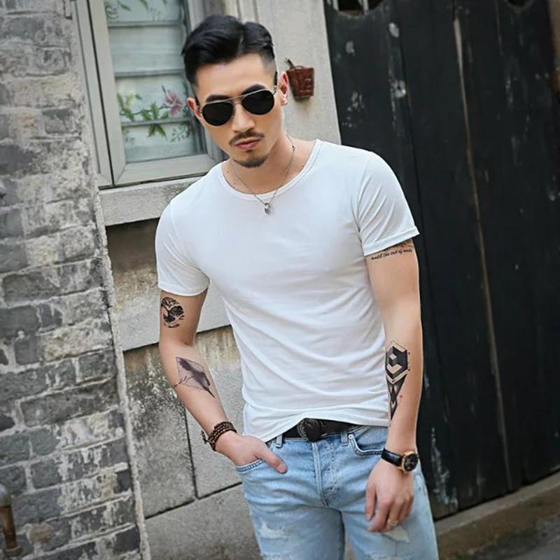 T-shirts Hommes Hommes Tshirt manches courtes Spandex Fitness Gym Vêtements Homme Tops T-shirt pour hommes de couleur masculine T-shirts Slim T-shirt XS-XXL