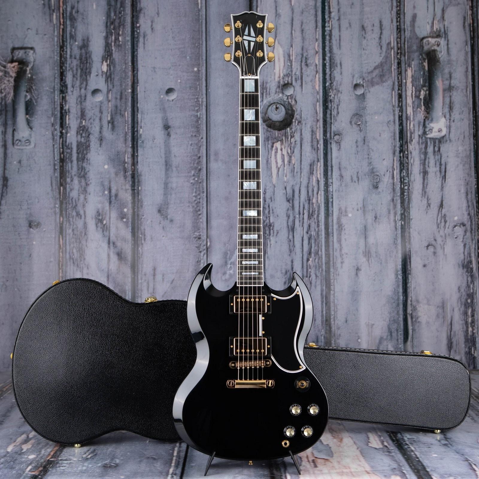 الجملة SG مخصص 2-pickup، خشب الأبنوس 6 سلاسل SG الغيتار الكهربائي، الجسم الماهوجني الصلب، الأجهزة الذهبية، التوصيل المجاني