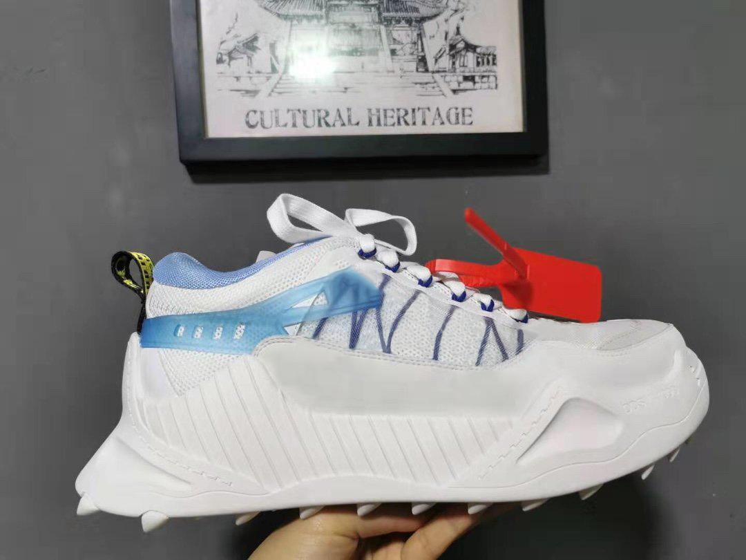 Venta al por mayor zapatos de diseño barato para hombres Mejor calidad de cuero genuino fuera de la marca deportiva zapatos para caminar zapatillas de deporte de diseño blanco 35-45