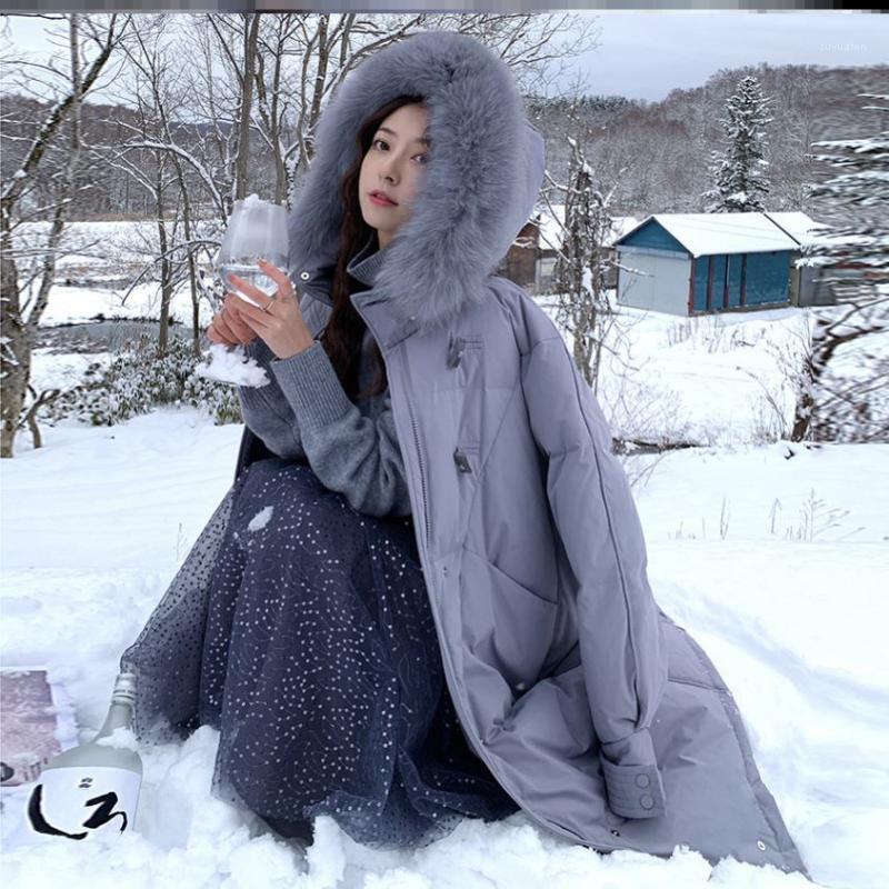 Xia Siwens Neue Daunenjacke Frauen Hornknopf Big Hair Collar Beliebte mittel- und langer Winter-Daunenjacke1