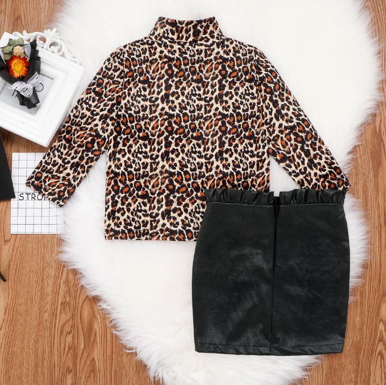 2021 Новые Детские Новые Детские Девушки Леопардовые Печать Рубашка с длинными рукавами + Бедра Кожаная Юбка Детский Двухсекционный костюм
