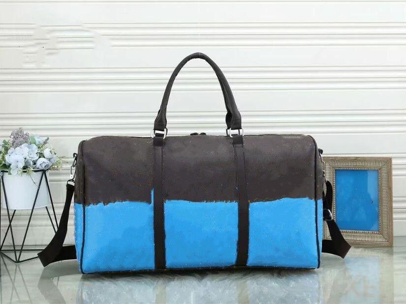 55 سنتيمتر النساء الرجال حقائب جديد أزياء الرجال النساء حقيبة سفر حقيبة واق، حقائب جلدية حقيبة جلدية كبيرة التباين حقيبة رياضية