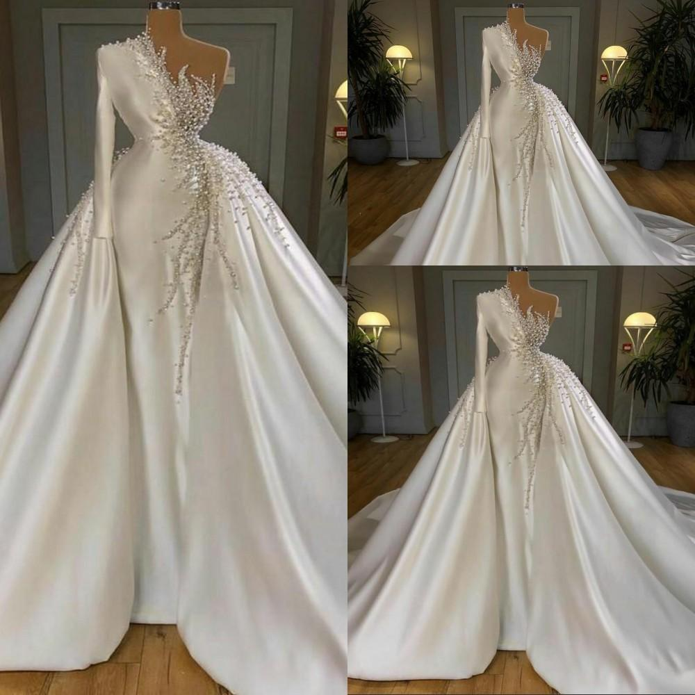 2021 New Luxury Mermaid Wedding Dresses Pearls Beadings One Shoulder Satin Long Sleeves Overskirts Detachable Train Ball Gown Bridal Gowns
