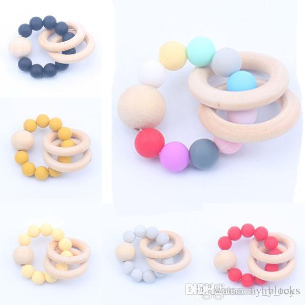 04 traqueador de madera colorido juguetes silicona toether natural bebe ejercicio dedos dedos accesorios infantiles juego de anillos de peinado de la dentición de los juguetes de la dentadura de los juguetes Lsia