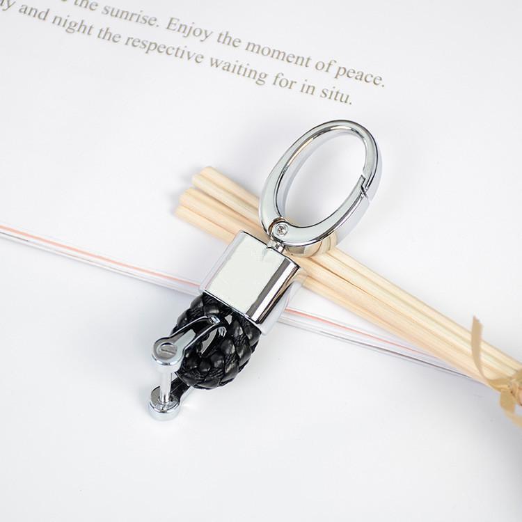 Porte-clés de voiture en cuir tissé à la main KeyRing Horseshoe Boucle Bijoux Keychains de porte-clés automobiles porte-clés pour BMW Benz VW Audi Ford