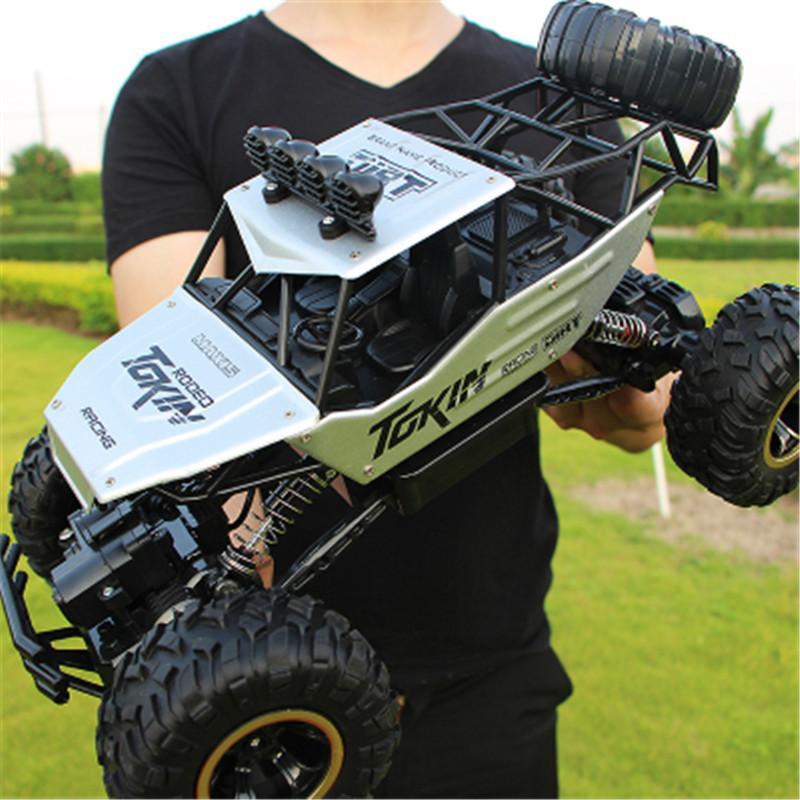 28 cm RC 1/16 4WD 4x4 conducción Double Motors Drive Bigfoot Control remoto Modelo de automóvil Modelo de vehículo todoterreno 201105
