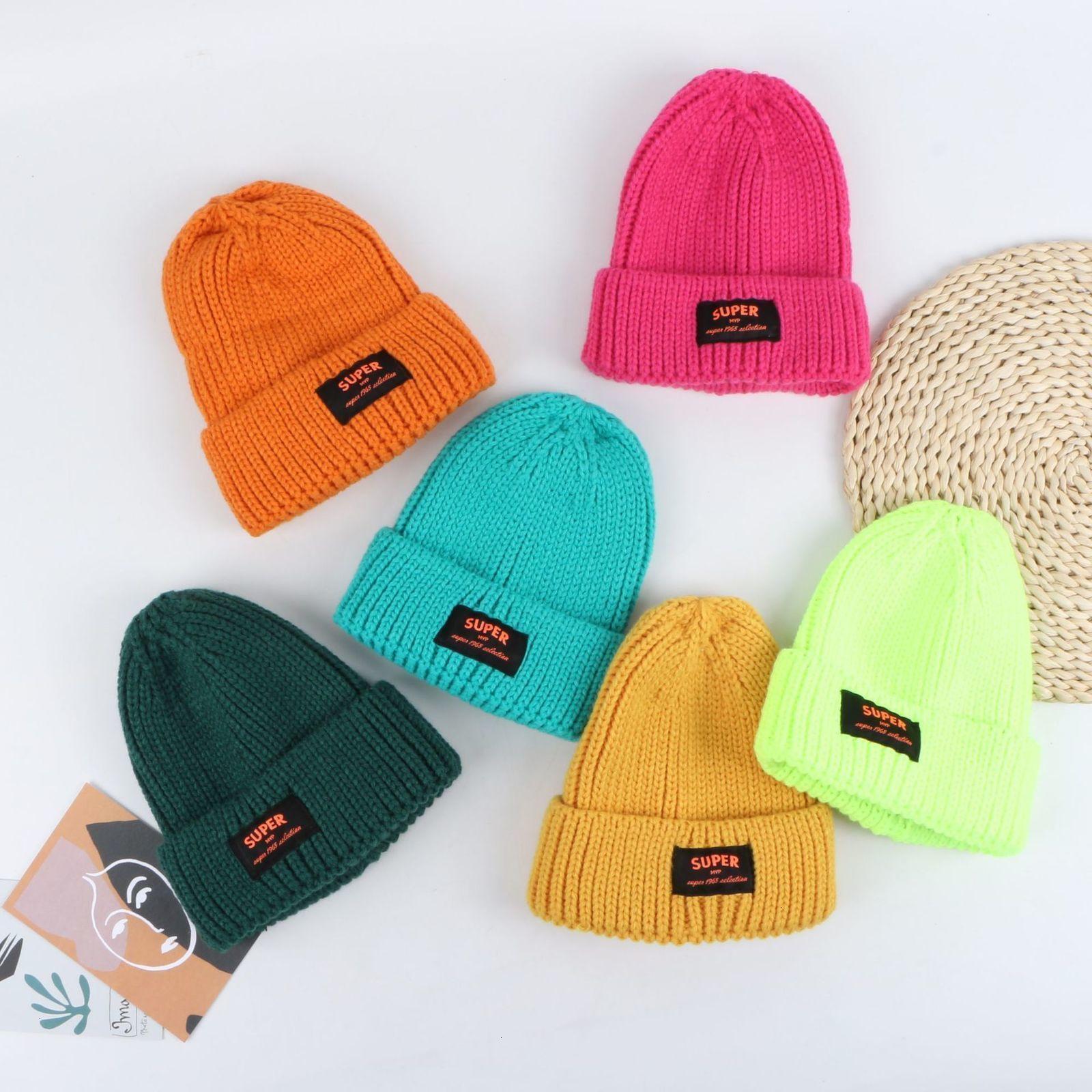 70% de descuento en invierno de la mujer Nueva capa doble engrosada de color puro de punto coreano casual versátil cálido sombrero de lana