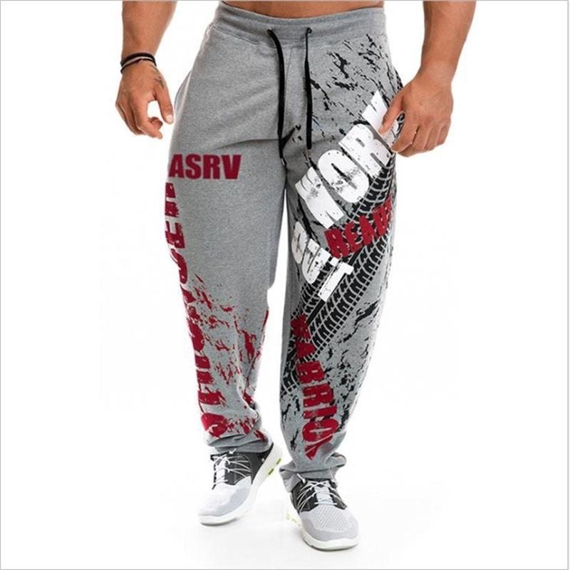 NUEVO Corriendo Jogging Hombres Algodón Soft Bodybuilding Joggers Sweatpants Harem Pantalones largos Fitness Deporte Pantalones Y201123