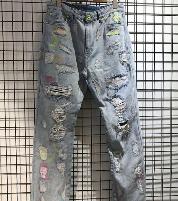Alto streetwear infinito dano buraco jean homens mulheres de alta qualidade botão metal zíper denim calças sem fim letra 3d impressão jean