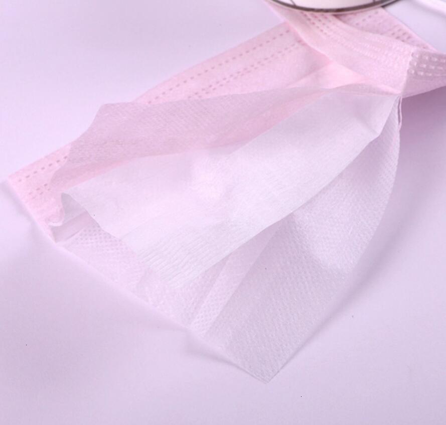 Masque anti-poussière non tissé anti-poussière non tissé respirant à la poussière à la poussière à poussière avec bandeau élastique rose noire blanche blanche mascherine gratuit