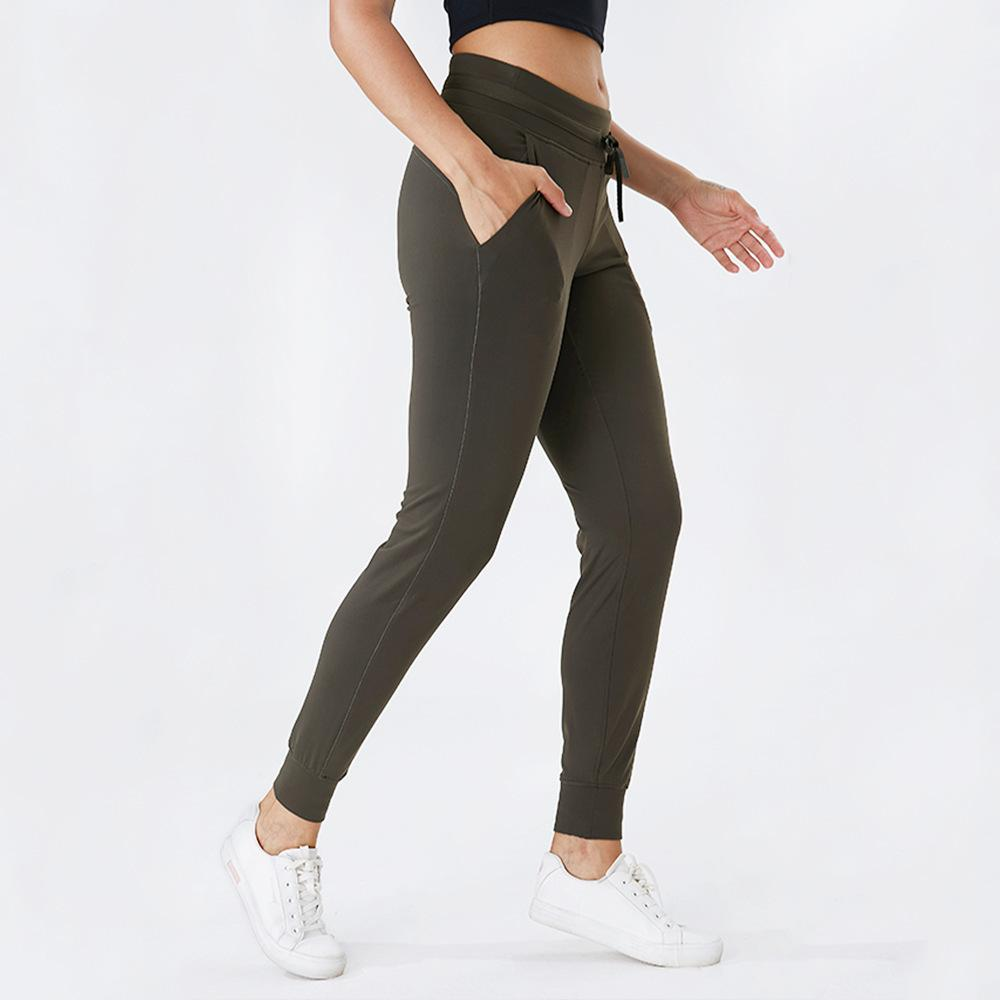 Sensation nue Tissu Pochette de poche Sport Sport Pantalons Jogger Femmes Slim Cordon Taille Taille Fitness Pannutisme X1227