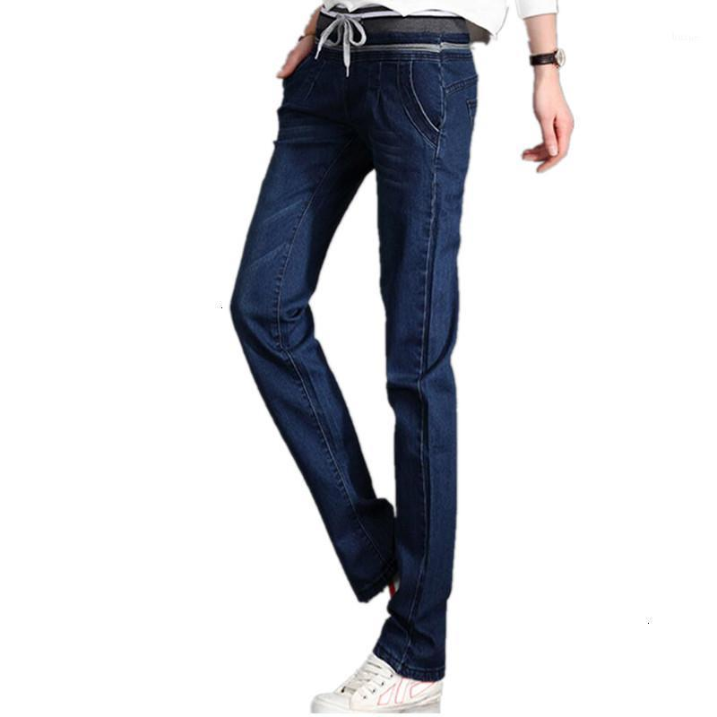 Женские джинсы извлекают стройные подходящие длинные джинсовые брюки таблетки Размер эластичные жилеты тонкие тканые повседневные ремешки женщины синий карандаш Brokek K2181