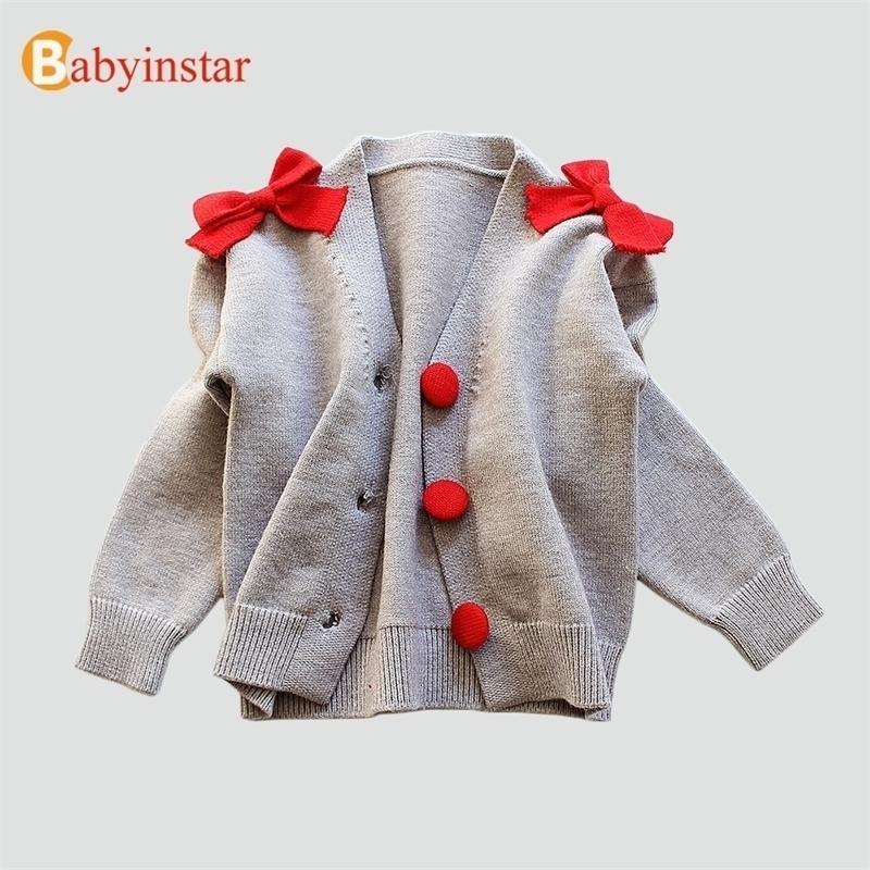 Babyinstar Toddler Chica de punto Outerwear Outerwear Ropa para niños Suéter Cardigan para niñas Botón Diseño con chicas de arco Cálido Cardigan 201126