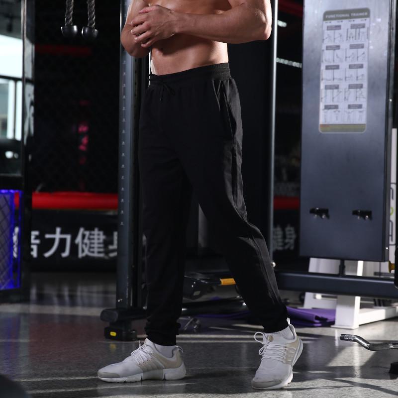 Funzionamento del calcio di fitness che si allenisce i pantaloni da gamba casual da uomo sportivi sottili