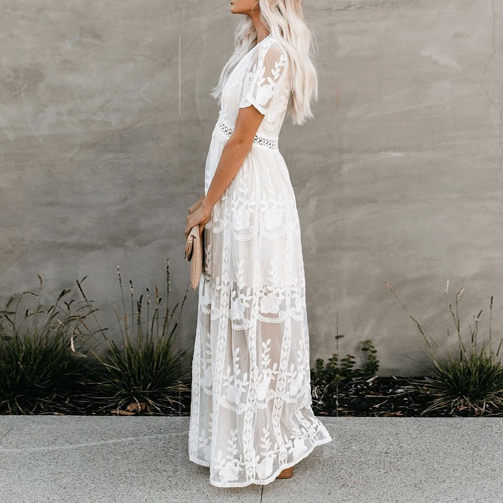 Kleine Spitze Nähte Spitze Häkeln Stickerei Süße Urlaubsstrand Europäische und amerikanische neue V-Ausschnitt Positionieren langes Kleid