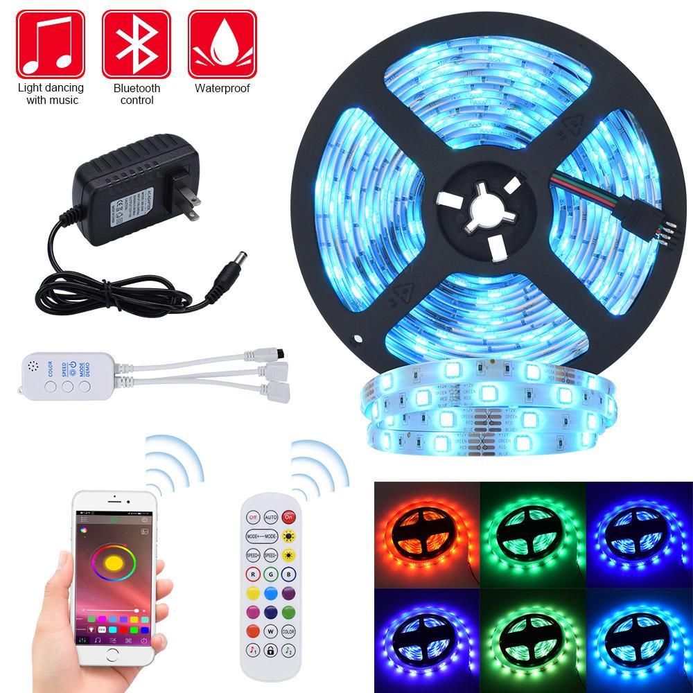 Светодиодные полосы света RGB обнажает 32.8ft лента света 300 светодиодов SMD5050 Водонепроницаемый Music Sync Изменять цвета + контроллер Bluetooth + 24key Remote Co