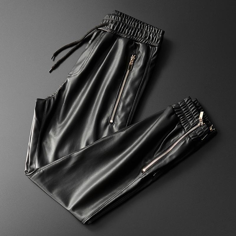 Thoshine uomini di marca Pantaloni in pelle di qualità superiore elastico in vita Jogger Pantaloni Zipper Pockets Ecopelle pantaloni dei pantaloni della matita 201118