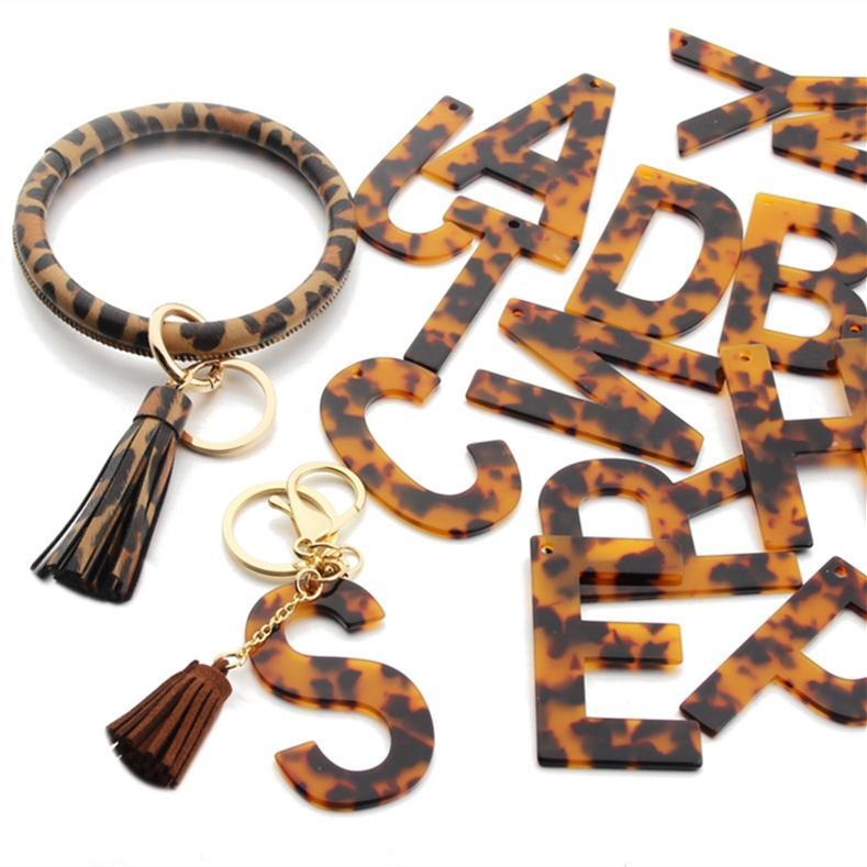 Léopard 26 lettres Pendentif Pendentif Chaîne de clé Femmes Hommes Porte-clés Acrylique A à Z Titulaire de porte-clés Porte-clés Charm de porte pour sac Clé de voiture Ornement DHL E120501