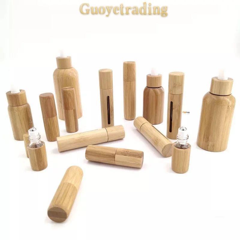 Bouteille d'huile essentielle bouteilles de parfum Bouette Bamboo Cas de bambou et Couvercle Inner Bouchons de Fonction pour le massage facial 3ML 5 ml 10 ml Capacités personnelles Emballage de soins personnels