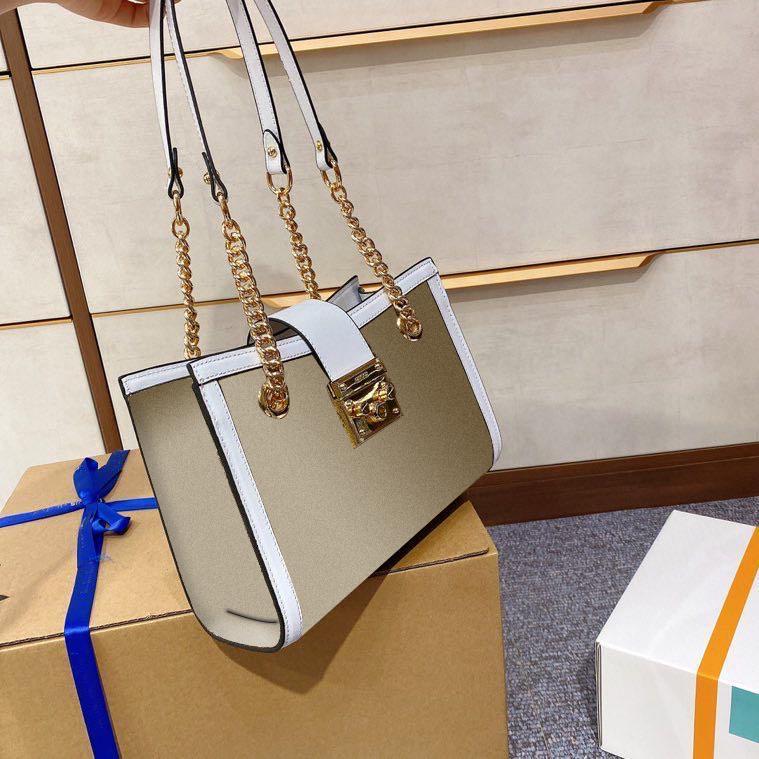 Luxueux designer designeur femmes épaule cadenas sac à main la chaîne de la chaîne de la mode 2021 toile en cuir véritable véritable bow rayures verrouillard avec sac USCRK