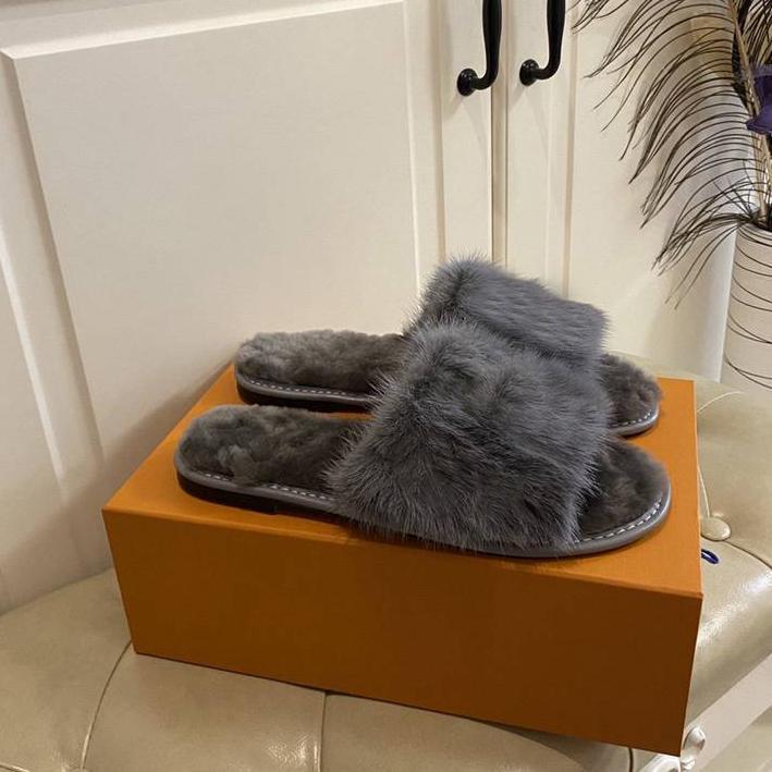 Nuevo diseñador de moda Unisex Mink Piel PLANDO DIBUJOS PLANDO MUJER HOMBRES HOMBRES Slippers Imprimir diapositivas Unisex Zapatillas de interior con caja