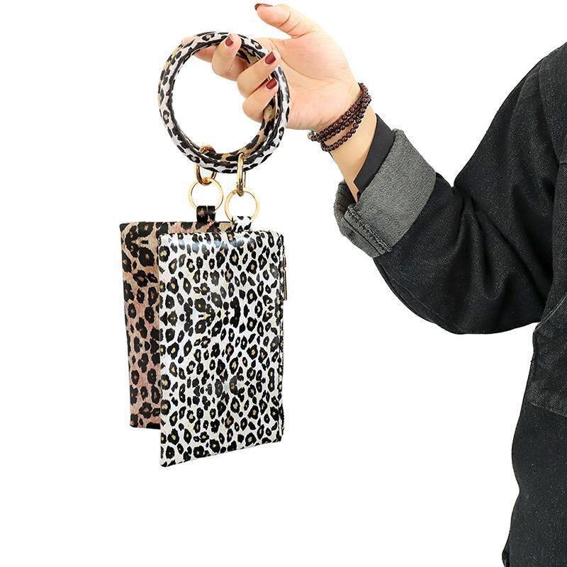 Leopardo estampado PU cuero tassel colgante pulsera niño niña cuero llavero pulsera billetera billetera teléfono móvil regalo de Navidad