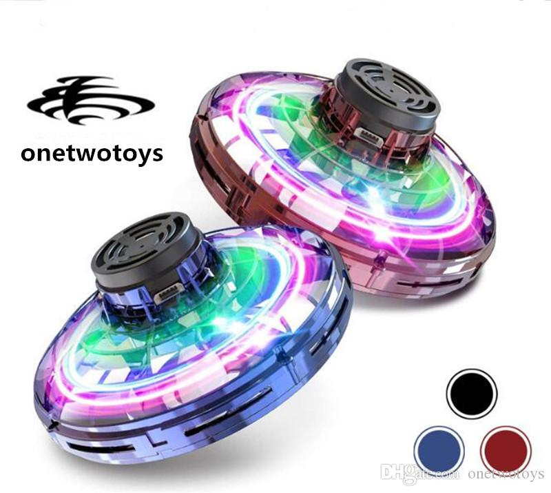 Más vendidos 100 unids / lote Original Flynova UFO GAG Toys Toys Spinners Mano Flying Spinner Mini LED Drone Saucer Light Spinning DecomPression Toys