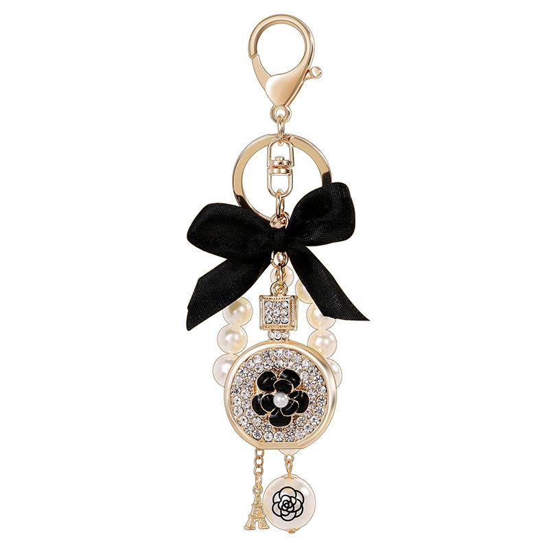 Adorável fofo arco pérola flor frasco de perfume chaveiros Novo Moda Ins Luxo Designer Diamante Sacênito Saco Chaveiros Borla