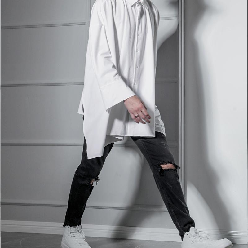 Jeans pour hommes américains hip hop déchirent pantalons mince pantalons petits pieds jeune jeune tendance britannique