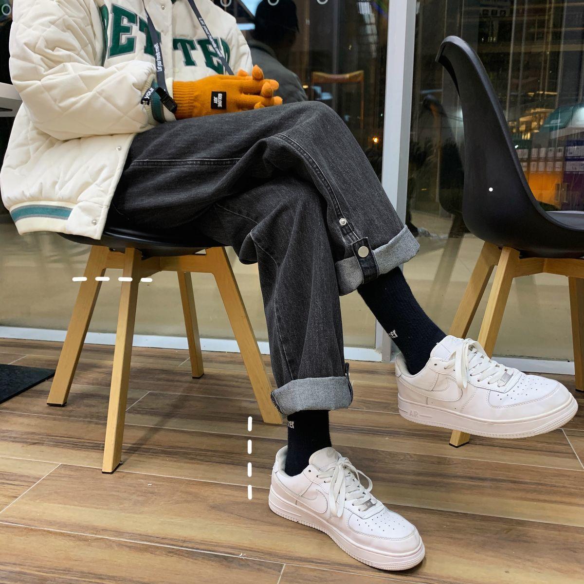 Los pantalones de mezclilla lavados sueltos de espesos de todos los combates se vuelven sobre el diseño del botón lateral pantalones rectos pantalones otoño invierno h1209