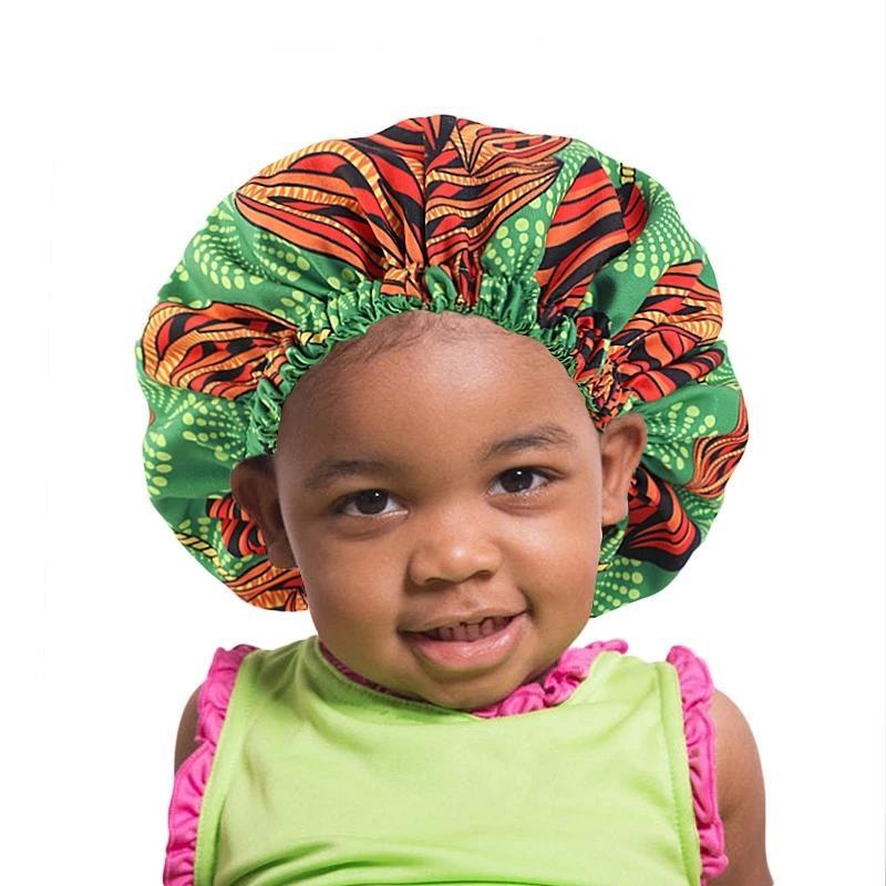 Bambini African Pattern Stampa Tessuto Ankara Bonnet Bonnet Donne Extra Grande Bonnet Allineati in satinata Notte Dormire Cappello da notte Ladies Turban Chemo Cap