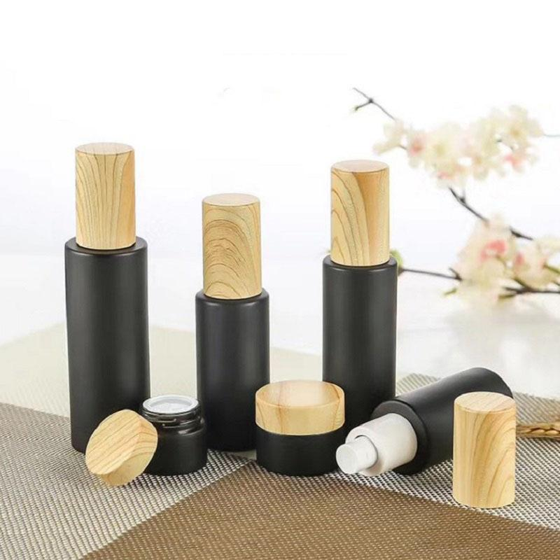 Empty glass pump bottles refillable black frosted glass lotion essential oil spray bottle with woodgrain plastic cap 20ml - 80ml KKF3390