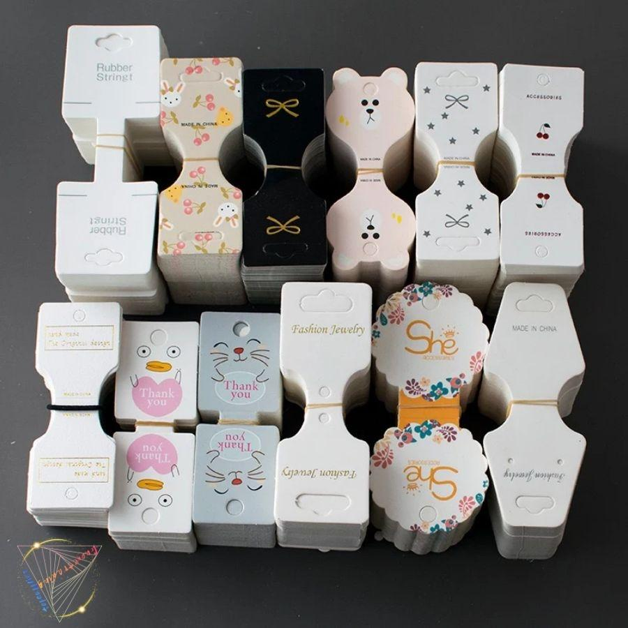 Accessoires pour cheveux Outils Tags en carton Tags Bandeau en caoutchouc Enroulement Papier Carte Collier Collier Coiffure Bijoux Emballage Cartes pliées 1000 pièces