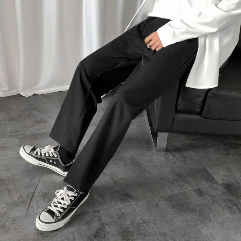 Pantalones para hombre Pantalones 2021 Primavera e invierno Color sólido de nueve puntos Ropa joven ocasional