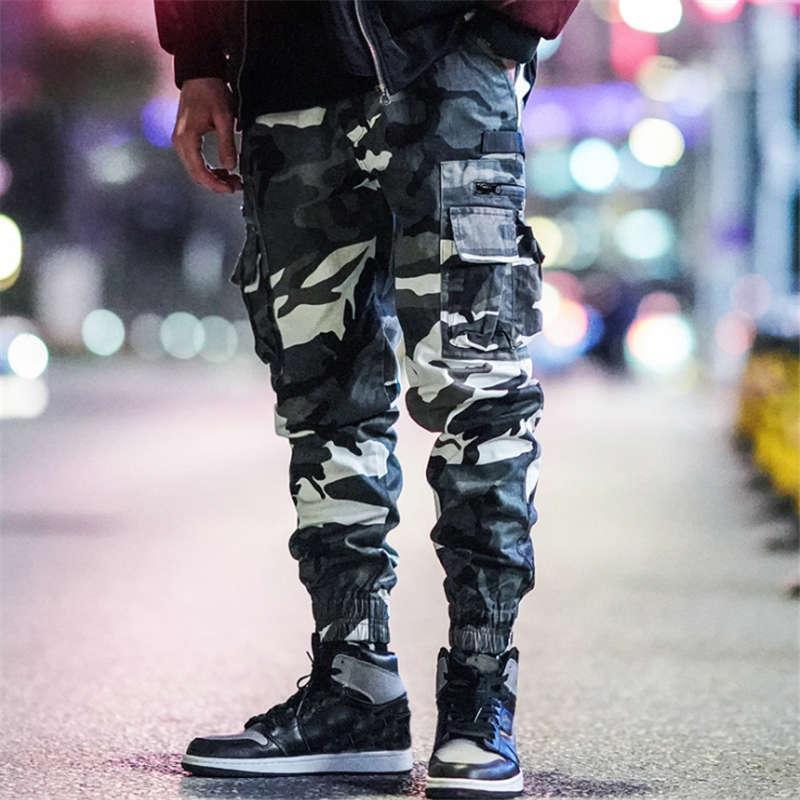 Уличный стиль Осенние камуфляжные комбинезоны мужские леггинсы Брюки уличные моды Функциональный ветер Мультикарманские сияющие Случайные брюки Размер M-3XL