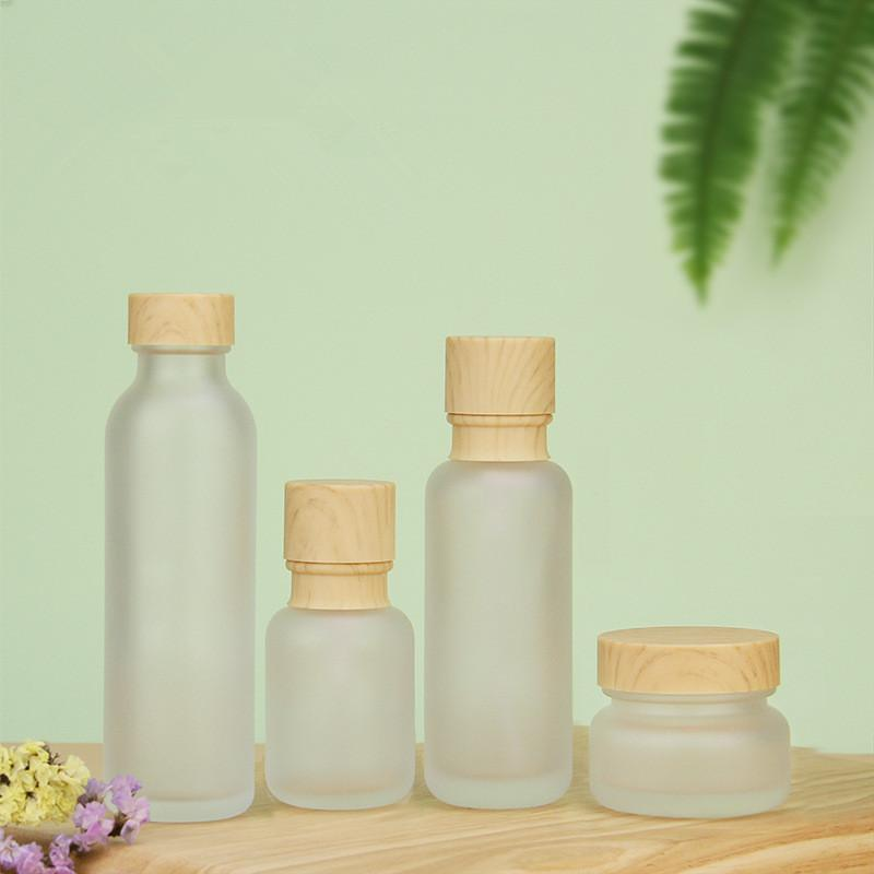 Frosted Glass Jar Lotion Cream Bottles Round Cosmetic Jars Hand Face Lotion Pump Bottle with wood grain cap Bottles HHA3475