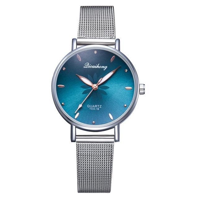 Womens Montres de luxe Fleurs Modèle Cadran Silver Inox Steel Bracelet Montre Dames Casual Quartz Horloge Mode Bracelet
