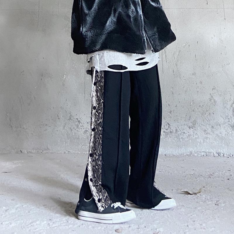 Panneau de survêtement de la molleton à double boutonnage Sweat Pullpants hommes et femmes Streetwear cordon de cordon de serrage à la jambe droite