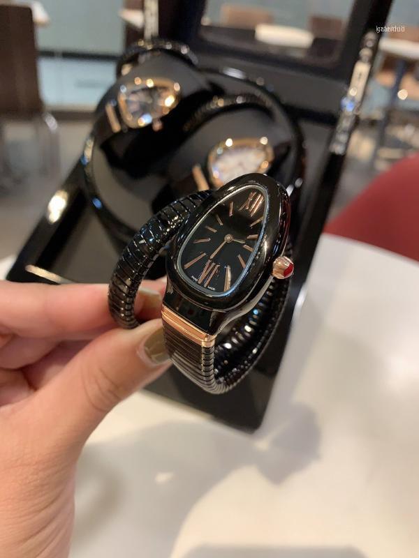 Armbanduhren Frauen Uhren Quarzbewegung Schlangenuhr Glatte uhr einfach und elegant11
