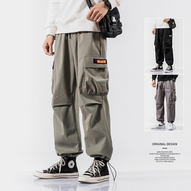 Kleidung Hosen Arbeit der Männer lose Bindung Gerade Rohr koreanische Art und Weise All-in-one Inschaopai Jiufen beiläufige Herbst Hosen