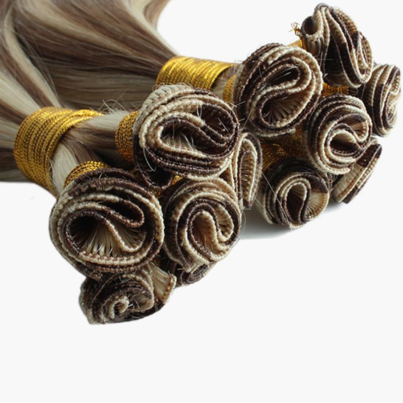 Paquetes de cabello humano Extensiones de cabello atadas a mano (trama de 9pcs por paquete) 150 gramos por paquete Tíbiz de mano trama de pelo 12-24 pulgadas