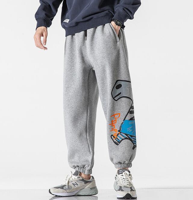 2020 Automne hiver japonais graffitis graffitis pantalons pour hommes Lettre chaleur de chaleur velours décontracté cordon de cordon harem jogger pantalon