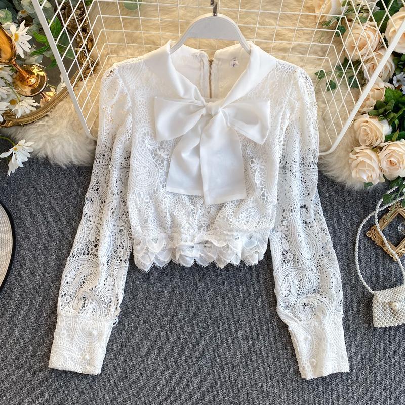 Arco de la vendimia Manga larga Blanco / Negro Hollow Out Lace Blusa Mujeres 2020 Primavera Otoño Oficina Elegante Oficina T Shirts Femenino