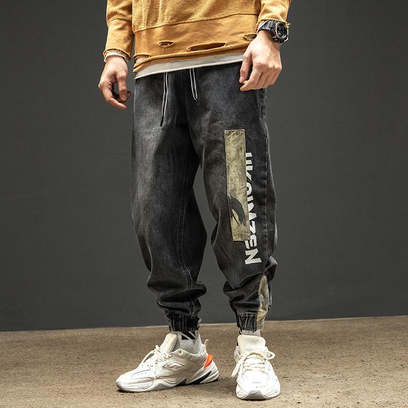 Atacado 2021 Moda Drawing Workwear Jeans Homens Gravata Pés Retro Stitching Patch Calças de Camuflagem Solta Harem Calças Y1205