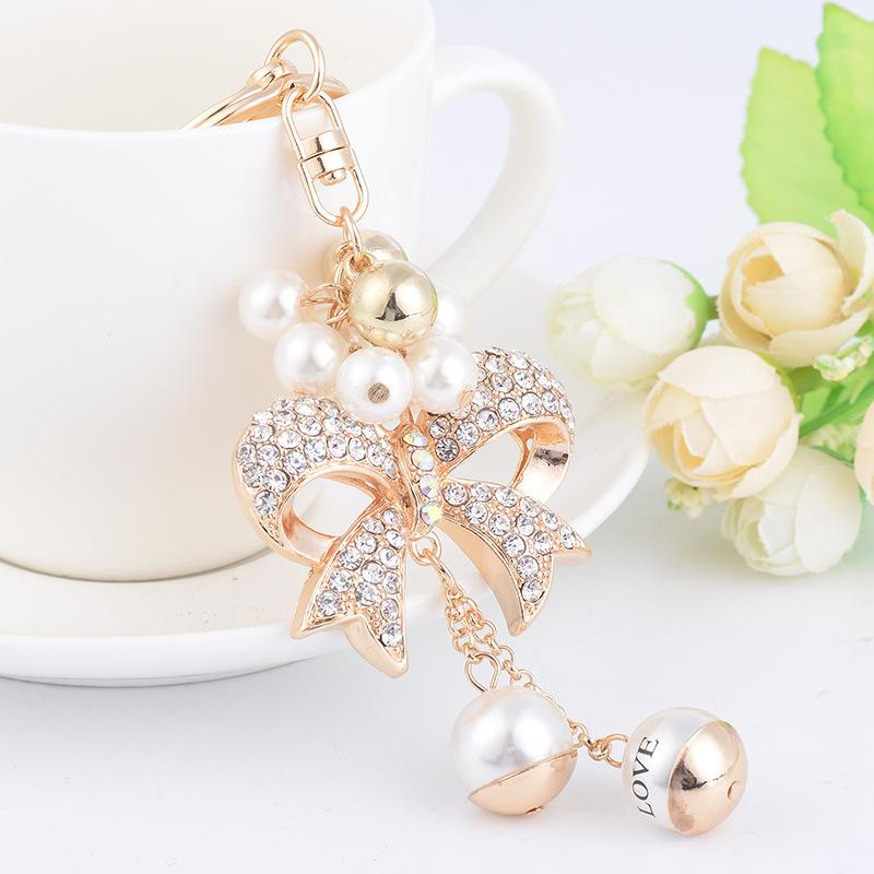 New Fashion Ins Ins Luxury Designer Diamond Strass Carino Bow Pearl Bag Charms Tassel Keychains Bianco Gold