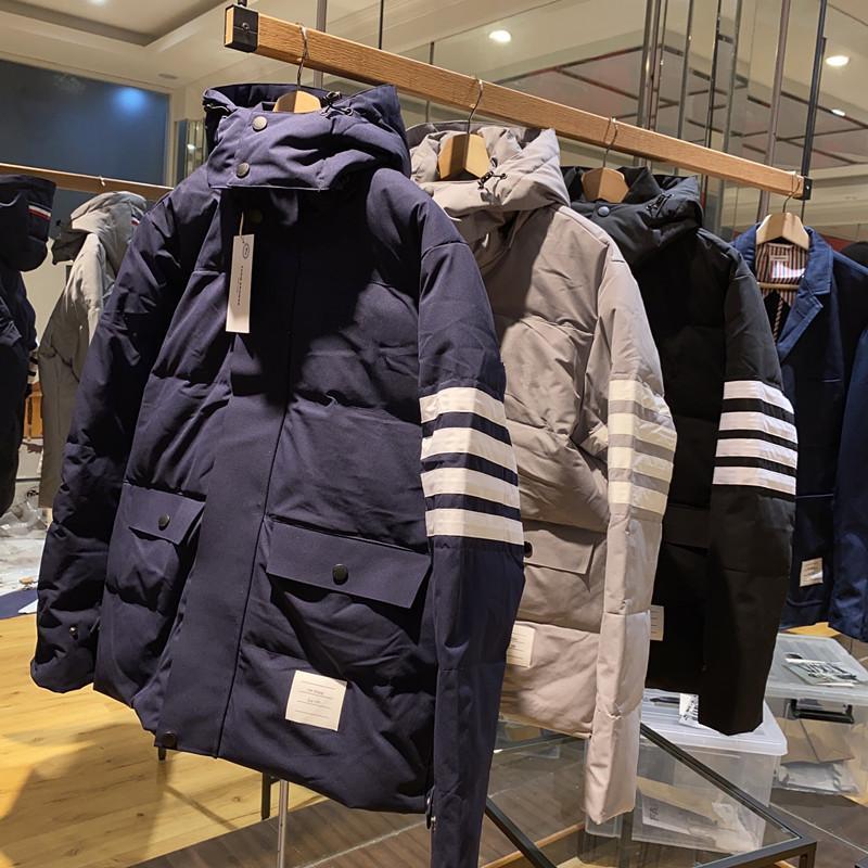 Ropa de plumas de otoño e invierno bordado gorra cálida hacia abajo para chaqueta mullida moda masculina y mujer